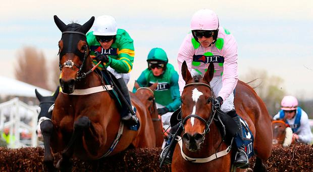 Up and over: Min, ridden by Ruby Walsh, on way to victory in the JLT Chase at Aintree