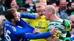 Boiling over: Andy Halliday and Scott Brown clash after Celtic's victory over Rangers