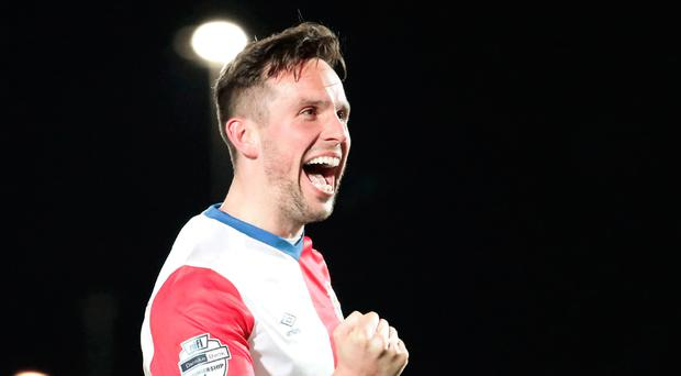 All over: Andy Waterworth celebrates after his winner against Ballymena United clinched title joy for Linfield last night
