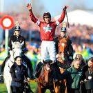 Jockey Davy Russell celebrates winning the Randox Health Grand National Handicap Chase with Tiger Roll.