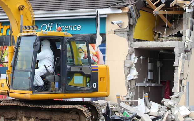 The scene at O'Kane's filling station outside Dungiven, Co. Derry, where an ATM was stolen with the aid of a digger in the early hours of Sunday morning. Picture by Jonathan Porter/PressEye