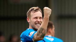 Rangers' Scott Arfield celebrates scoring his sides second goal during the Ladbrokes Scottish Premiership match at Fir Park, Motherwell. Photo credit: Jane Barlow/PA Wire