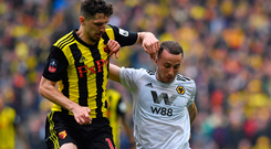 Tough battle: Craig Cathcart and Diogo Jota fight for possession during the FA Cup semi-final