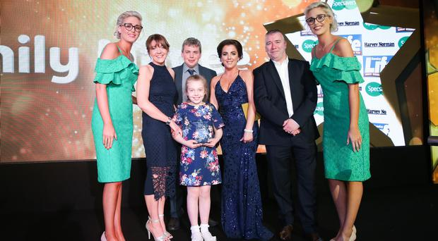 Winner of the Spirit of Youth award, Emily Magee (8) from Co. Fermanagh, is presented with her trophy by Eamonn McFadden, from category sponsor Harvey Norman and 'Derry Girl' Jamie Lee O'Donnell. Photo by Kelvin Boyes / Press Eye