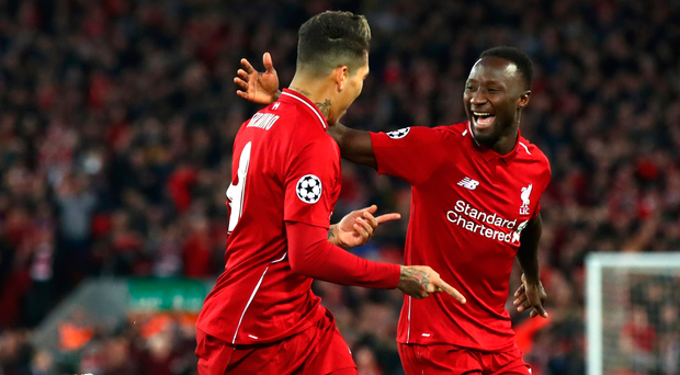 Get in: Naby Keita (right), with Roberto Firmino, after scoring Liverpool's first goal last night