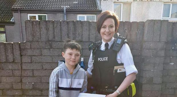 Tiernan McCready was honoured by police for his bravery.