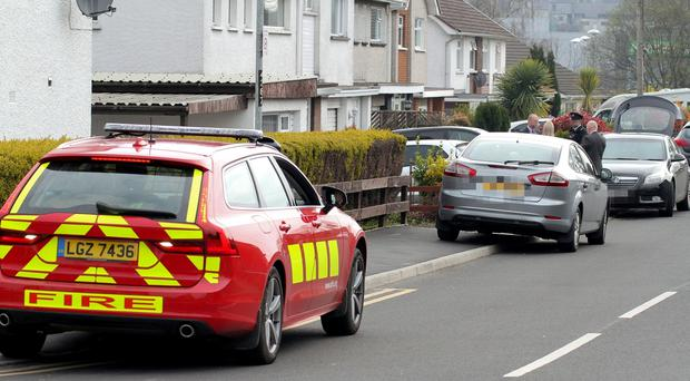 Emergency services assess the scene of a house fire in Millburn Avenue, Cookstown. Picture: Presseye