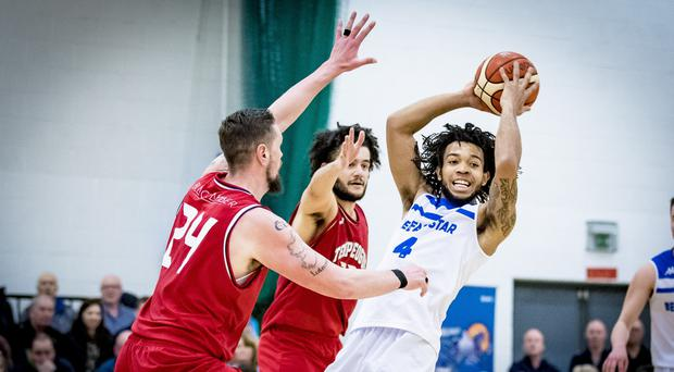In hand: Belfast Star ace Mike Davis in action against Templeogue