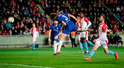Head man: Marcos Alonso scores the winner for Chelsea