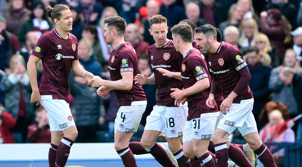 John Souttar celebrates scoring Hearts' second goal of the day.
