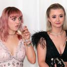 Maisie Williams (left) and Kerry Ingram attending the Game of Thrones Premiere, held at Waterfront Hall, Belfast. PRESS ASSOCIATION Photo. Picture date: Friday April 12, 2019. See PA story SHOWBIZ Thrones. Photo credit should read: Liam McBurney/PA Wire