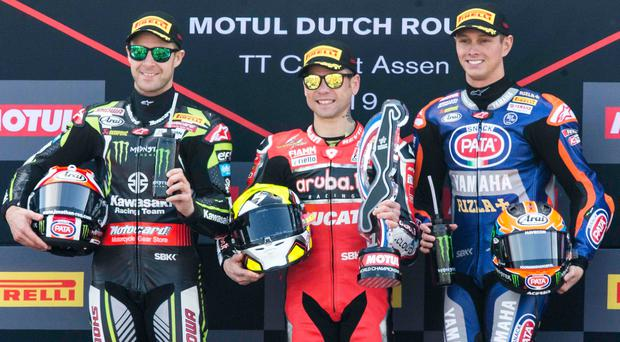 Tough weekend: Alvaro Bautista celebrates his win on the podium between second placed Jonathan Rea (left) and third placed Michael van der Mark (right) after the first race of the World Superbike Championship moto races at the TT Circuit Assen in Assen