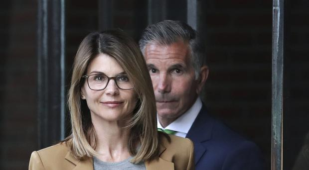 Actress Lori Loughlin and her husband Mossimo Giannulli (AP Photo/Charles Krupa)