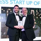 Darragh McCarthy (right) of sponsors Fintru presents Gareth Irvine of Copeland Spirits with last year's award