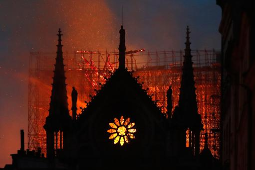 Flames and smoke rise from Notre Dame cathedral as it burns in Paris, Monday, April 15, 2019. (AP Photo/Thibault Camus)