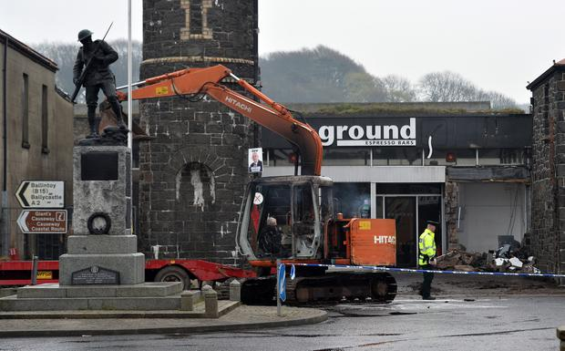 PACEMAKER BELFAST 15/4/2019 The scene after a cash machine was stolen in Bushmills in Co Antrim, Thieves have used a digger to rip a cash machine from the wall of a shop.The incident happened in Market Square early on Tuesday morning.The digger was set on fire. Photo Colm Lenaghan/Pacemaker Press