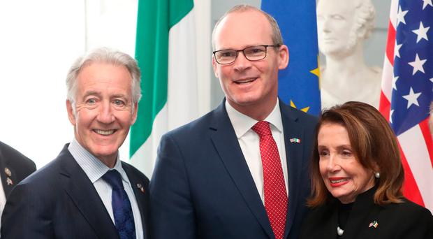 US House of Representatives speaker Nancy Pelosi (right) and Congressman Richard Neal (left) are greeted by Simon Coveney. Photo credit: Niall Carson/PA Wire