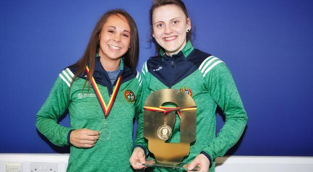 Carly McNaul and Michaela Walsh celebrate after their medal success at the World Cup in Cologne.
