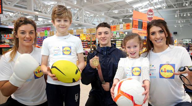 Local sports stars Leah McCourt, Rhys McClenaghan and Bethany Firth along with Leo Cullen and Ellie McGuigan at the Lidl Connswater store.