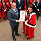 Rory Best receives his scroll from Lord Mayor Julie Flaherty as members of Armagh City, Banbridge and Craigavon Borough Council look on