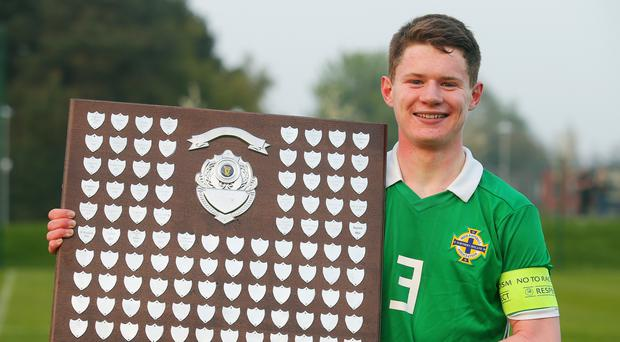 Top class: NI U18 captain Patrick Burns with the Centenary Shield