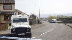 Press Eye - Belfast - Northern Ireland - 19th April 2019 - Photo by Lorcan Doherty / Press Eye. PSNI officer close off Fanad Drivem in Creggan, Derry following the murder of 29-year-old Lyra McKee during rioting after police searches in the area last night.