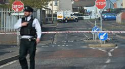 Police at the scene after a journalist was shot dead in Derry during rioting. Photo Colm Lenaghan/Pacemaker Press