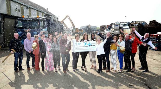 The Tinnelly Group syndicate celebrate their £250k EuroMillions win.