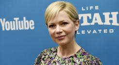 """FILE – In this Jan. 24, 2019, file photo, Michelle Williams, a cast member in """"After the Wedding,"""" poses at the premiere of the film on the opening night of the 2019 Sundance Film Festival in Park City, Utah. Michelle Williams and Phil Elverum have separated after less than of marriage. A person close to the couple who wasn't authorized to comment on the matter confirmed the split Friday, April 19, 2019. It was first reported by People magazine. The 38-year-old Oscar-nominated actress and the 40-year-old musician were wed last July in upstate New York. (Photo by Chris Pizzello/Invision/AP, File)"""