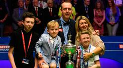 Proud moment: Mark Williams and family after last year's title triumph at the Crucible
