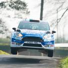Lift off: Craig Breen flies into the lead on day one of the Easter Stages Rally yesterday