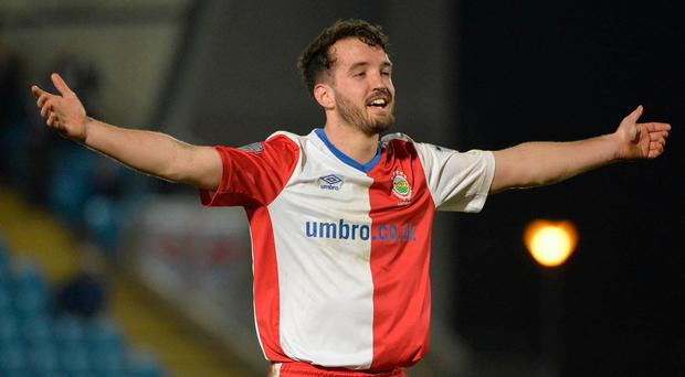 Job done: Josh Robinson celebrates at the end of the Ballymena United clash earlier this month
