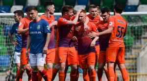 Glenavon beaten Linfield 4-0 at Windsor Park to keep alive their hopes of an automatic European place.