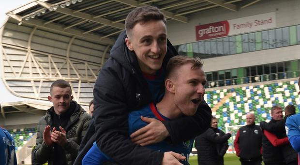 Linfield's Joel Cooper and Andrew Mitchell celebrate winning their first Irish League title at the Blues.