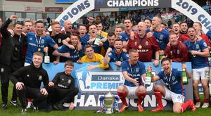 Who will Linfield face in the second round of European football this summer?