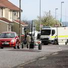 PSNI and Army Technical Officers deal with a suspect device left at the home of local Councillor Gary Donnelly on Inishcarn `Road, Creggan, Derry.