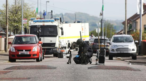 Army Technical Officer at the scene of a security alert in Creggan. Credit: Press Eye