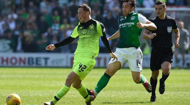 Celtic's Callum McGregor (left) and Hibernian's Stevie Mallan battle for the ball during the Ladbrokes Scottish Premiership match at Easter Road, Edinburgh. Ian Rutherford/PA Wire.