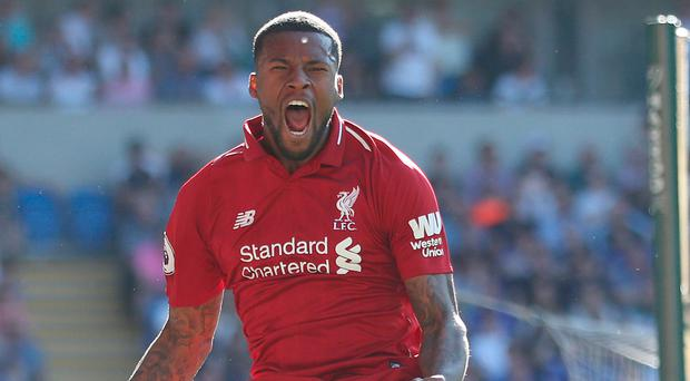 Victory roar: Georginio Wijnaldum celebrates his stunning goal against Cardiff City