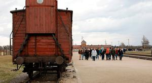 A party of visitors at the railway line where prisoners were ferried into Auschwitz II-Birkenhau