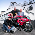 Revved up: McAdoo Kawasaki Racing's Adam McLean, Clerk of the Course Bill Kennedy and Bayview Hotel owner Trevor Kane