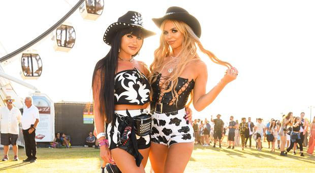 Festival goers attend the 2019 Coachella Valley Music And Arts Festival - Weekend 2 on April 21, 2019 in Indio, California. (Photo by Presley Ann/Getty Images for Coachella)