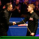 You earned it: Ronnie O'Sullivan (left) congratulates James Cahill on his stunning victory at the Crucible yesterday