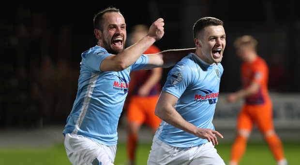 Overjoyed: Shane McGinty leads the celebrations for David Jeffrey's Ballymena United