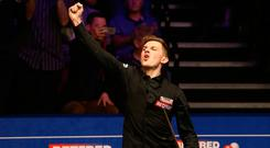 What a feeling: James Cahill celebrates his shock victory over Ronnie O'Sullivan at the Crucible