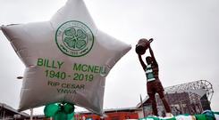 Celtic legend: tributes to Billy McNeill, who died on Tuesday, are seen outside Celtic Park yesterday
