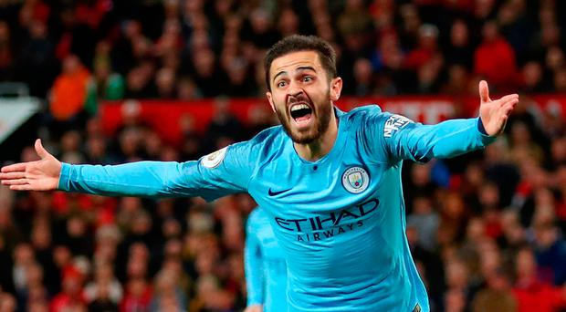 Class above: Bernardo Silva wheels away in celebration after scoring the opener for Manchester City
