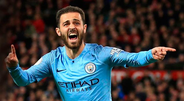 City slicker: Bernardo Silva sends Pep Guardiola and his team on their way to victory at Old Trafford last night