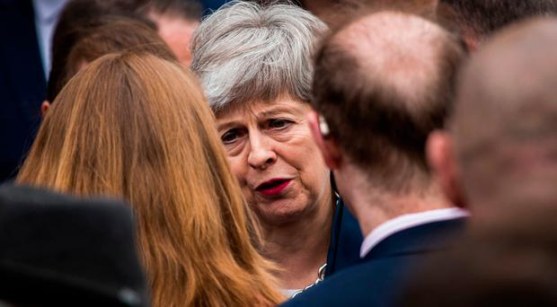 Paying respects: Prime Minster Theresa May after the funeral