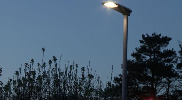The Department of Infrastructure is replacing street lights with new LED lights. Credit: BBC